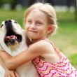 Little girl with her dog — Stock Photo #13469605