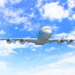 White passenger plane in blue sky — Stock Photo #13469733