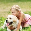 Little girl with her dog — Stock Photo #13469799