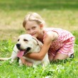 Little girl with her dog — Stock Photo #13469867