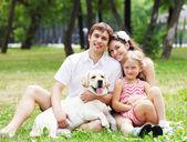 Happy family having fun outdoors — Stock Photo