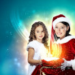 Little girl with christmas gifts and santa — Stock Photo #13480678