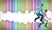 Young man dancing and jumping... — Stock Photo