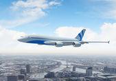 White passenger plane flying above a city — Stock Photo