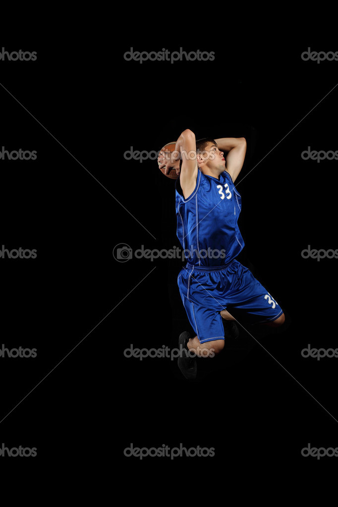 Male basketball player jumping and practicing with a ball — Stock Photo #13480599