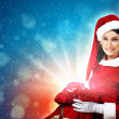 Beautiful girl in santa costume - Stock Photo