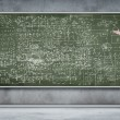 Business person against the blackboard — Stock Photo #13528191