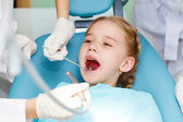 Little girl visiting dentist — Stock Photo