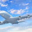White passenger plane in blue sky — Stock Photo #13553554