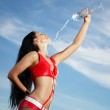 Young female sport girl with a bottle of water — Stock Photo #13553870