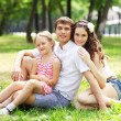 Happy family having fun outdoors — Stock Photo #13553937