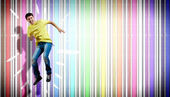 Young man dancing and jumping... — Stock Photo