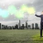 Бизнесмен с красочными луч света в его руках — Стоковое фото