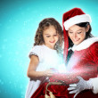 Little girl with christmas gifts and santa — Stock Photo