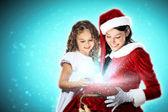 Menina com presentes de natal e papai noel — Fotografia Stock