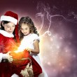 Little girl with christmas gifts and santa — Stockfoto #13694015