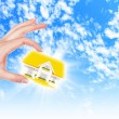 The house in hands on blue sky — Stock Photo #13742453