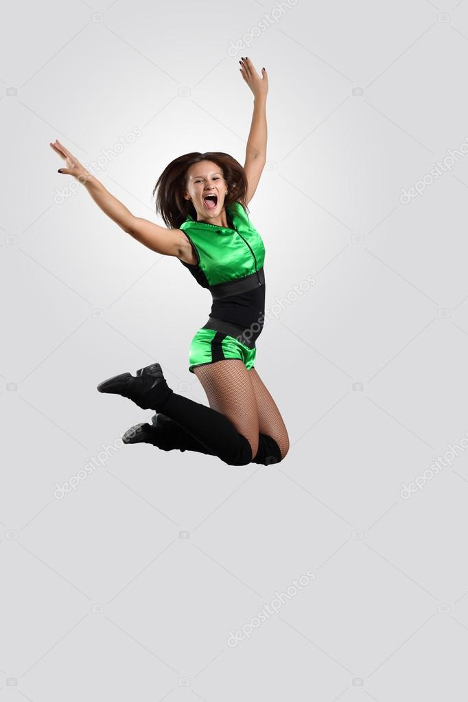 Young female dancer jumping against white background  Stock Photo #13742417