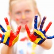 Happy child with paint on the hands — Stock Photo #13853622