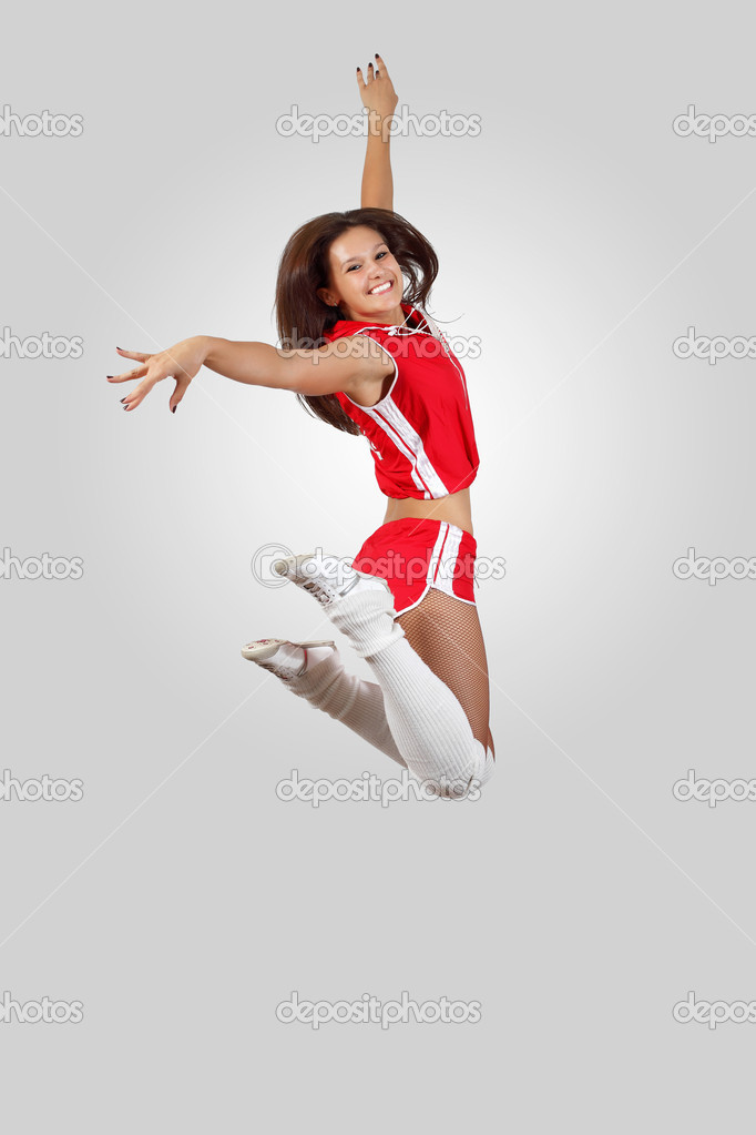 Young female dancer jumping against white background — Stock Photo #13867098