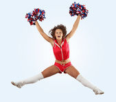 Cheerleader girl jumping — Stock Photo