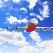 White passenger plane in the blue sky — Stock Photo