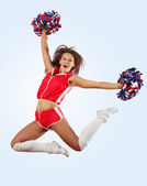 Cheerleader girl jumping — Stock Photo