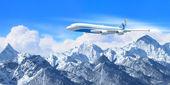White passenger plane above the mountains — Stock Photo