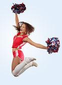 Niña porrista saltando — Foto de Stock