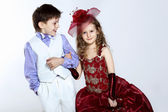 Little girl in beautiful dress and boy — Stock Photo