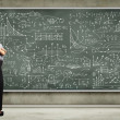 Business person against the blackboard - Foto Stock