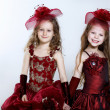 Little girls in beautiful dress - Stock Photo