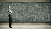 Business person against the blackboard — Stok fotoğraf