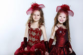 Little girls in beautiful dress — Стоковое фото