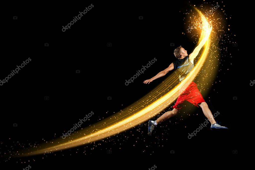 Male basketball player jumping and practicing with a ball — Stock Photo #14136636