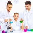 Team of scientists working in laboratory — Stock Photo