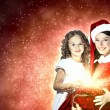 Little girl with christmas gifts and santa — Stock Photo #14216811