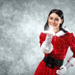 Portrait of girl wearing santa claus clothes - Stockfoto