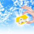 The house in hands on blue sky — Stock Photo