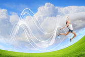 Modern style dancer against blue sky — Stock Photo