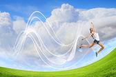 Modern style dancer against blue sky — Stock Photo