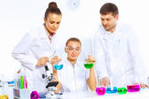 Team of scientists working in laboratory — Photo