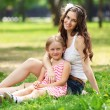 Stock Photo: Mother and daughter in park