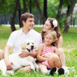 Happy family having fun outdoors — Stockfoto