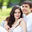 Stock Photo: Young love Couple smiling under blue sky