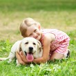 Little girl with her dog — Stock Photo #14343619