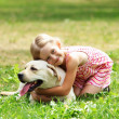 Little girl with her dog — Stock Photo #14343667