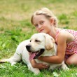 Little girl with her dog — Stock Photo #14343991