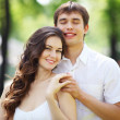 Young love Couple smiling under blue sky — Stock Photo #14344003