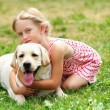 Little girl with her dog — Stock Photo #14344069